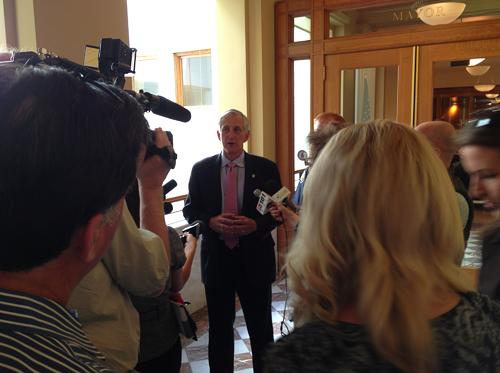 Mayor Charlie Hales. At left, the back of Lars Larsons head.